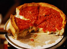 In Chicago's Pizzeria Uno developed the first deep-dish pizza. Rather than a flat crust, a deep-dish pizza has a thick flour and cornmeal pizza crust Chicago Style Pizza, Pizza Style, Deep Dish, The Blues Brothers, State Foods, Serious Eats, Chicago Restaurants, Relleno, Places To Eat