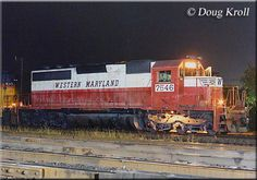 Western Maryland SD40 #7546 and Chessie System GP40-2 #4315 idle away at the B&O's once large classification yard in Keyser, West Virginia on the night of September 20, 1980.