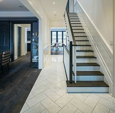 foyer with dark stair treads, white risers, dark railing, white spindles, wainsc… – Flooring Entryway Tile Floor, Entry Tile, Entryway Flooring, Kitchen Flooring, Kitchen Tile, Tile Flooring, White Tile Floors, Kitchen With Tile Floor, Marble Herringbone Tile