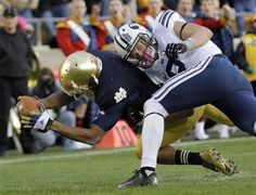 Notre Dame running back George Atkinson III is hit by BYU defensive back Daniel Sorensen as he dives in for a 20-yard touchdown run