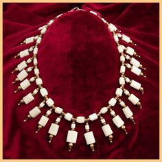 This African carved water buffalo bone necklace is from Mali. Each piece is carved with intricate patterns and delicately polished. This necklace
