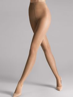 A perfect basic item: The semi-sheer tights feel like a second skin thanks to top-quality fine elastane. A light shimmer gives the tights a silky and elegant look, and the comfortably soft knitted waistband provides a perfect fit. Knitted waistband featuring the Wolford logo Almost invisible toe reinforcement (Shadow Toe) Cotton gusset A perfect enhancement for a range of occasions.