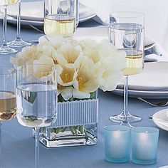 Wedding Flowers: Wedding Centerpiece - clear vases filled with delphinium,sweet pea,blue hydrangeas,and white tulips wrapped in ribbon