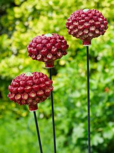 Lollipop Pom Poms - thrown and modeled stoneware with metal and timber