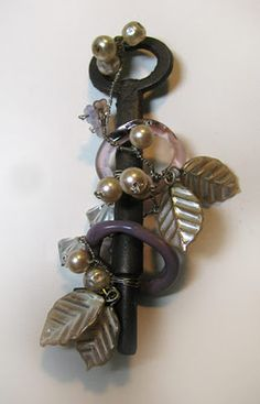 i could get a bunch of antique keys and attach a little card with name and table number as wedding favors
