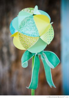 Paper Globe made from pretty scrap book paper. - Thinking of making these to hang for a mobile in baby's room.