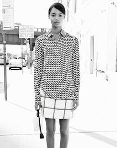 Today has been christened Work Like A Dog Day. Seriously. We choose not to look like one.Malaika Firth in aMarc Jacobs top, 3.1 Phillip Lim skirt, and Mark Cross bagMarc Jacobs fan-print button-up blouse, $550For information: marcjacobs.com