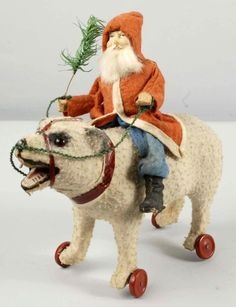 Santa riding polar bear pull toy.