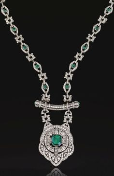 An important Art Deco emerald and diamond sautoir, French, Circa 1930. A series of openwork lozenge and stylised circular links set with circular- and single-cut diamonds, the former accented with cabochon emeralds, suspending an openwork pendant of Persian design, centring on an emerald, accented with circular-, single-cut and baguette diamonds, supported on a curved bar with cabochon emerald terminals, mounted in platinum. French assay marks, separates into four bracelets and a brooch.