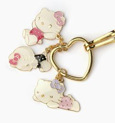 270e122495 Blissful  HelloKitty heart-shaped keyring with enamel and goldtone charms  Hello Kitty Keychain