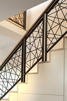 50 Amazing and Modern Staircase Ideas and Designs — RenoGuide - Australian Renovation Ideas and Inspiration Black Stair Railing, Staircase Railing Design, Wrought Iron Staircase, Balcony Railing Design, Curved Staircase, Metal Railings, Staircase Ideas, Window Grill Design Modern, Modern Stairs