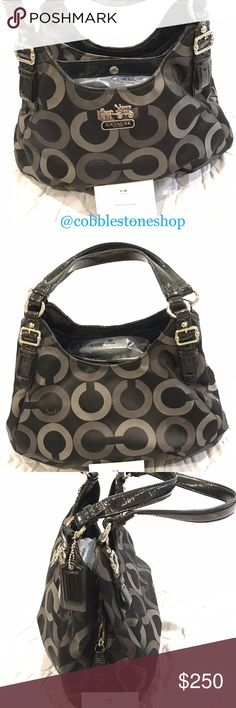 "Coach op art Maggie hobo bag 20244 Coach op art Maggie hobo bag 20244 Black  Jacquard  MEASUREMENTS: 12""(L) x 9.5""(H) x 7""(D) Signature multi fabric with grey and black ""C's"" Zip top closure with leather pull tab Double patent leather handles Silver tone  3 compartments Middle zippered compartment 2 exterior compartments with magnetic, snap closure Interior zippered pocket Interior multi function slip pockets Coach Bags"