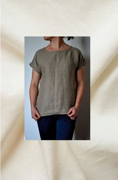 Natural linen blouse for women.  Blouse has round neckline and midi length…