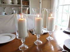 *DIY Dollar Store Hurricane Candle Holders* You will need:Tapered Glass Candle Holders,Cylinder Glass Vases, E-6000 Craft Adhesive,Candles. Instructions: Place some E-6000 Craft adhesive on the bottom of the Cylinder Glass Vase and then take the Tapered Glass Candle holder and attach it to the bottom of the Cylinder Vase. Wait till Candle Holder is completely dry before use. This is such a easy and simply way to create a beautiful look!