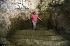 A 2,000 year old miqwe bath has been discovered under a family living room in the 'Ein Kerem neighbourhood of Jerusalem. It has been hewn from the bare rock but had been carefully plastered, according to archaeologists. Tal Shimshoni, who discovered the bath beneath his living room, is shown above in the miqwe