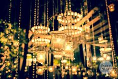 Karishma and Jyotveer | Anandkaraj | Sikh wedding in Delhi | The candle chandeliers shine as the wedding decor looks beautiful.| Wedding centrepiece ideas story monk | Every Indian bride's Fav. Wedding E-magazine to read. Here for any marriage advice you need | www.wittyvows.com shares things no one tells brides, covers real weddings, ideas, inspirations, design trends and the right vendors, candid photographers etc.