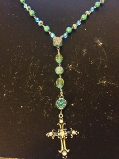 The rosary kit is what started my interest in making jewelry and here is one of them that I made. I bought the beads and other material at walmart.