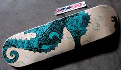 Originally a hand drawn ink pen graphic, today's Featured Deck by Mary Feather seems to be a deep sea diver discovering the most enormous seahorse ever. www.BoardPusher.com skate skateboard skateboards skateboarding sk8 art artist