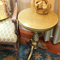 Give a simple side table a chic makeover with pearl trim and resin! Hit the table with some gold paint before you add the pearls to give the resin a beautiful g…