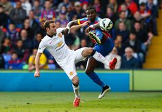 Juan Mata in action with Pape Souare