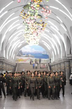 Female soldiers at subway station, Pyongyang