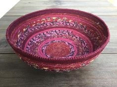 Burgundy Wine colored Fabric Bowl - The bowl measures approximately 8.5 inches across and is about 3.25 inches deep.