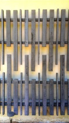 Wall Sculpture. A blank facade is the perfect backdrop for this weathered wood wall sculpture on a vintage mid-century modern house in the Hollywood Hills.