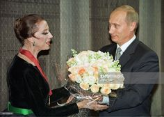 Russian President Vladimir Putin congratulates celebrated Russian ballet dancer Maya Plisetskaya on her 75th birthday jubilee with a bouquet of seventy-five roses in the Bolshoi Theatre 20 November 2000. Addressing the audience, Putin said, 'We are proud that we can call an artist of such fame a Russian ballerina'.