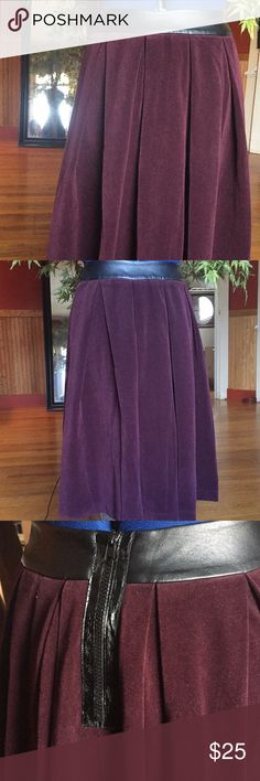 """The People's velour burgundy faux leather skirt 0 Excellent condition. NO FLAWS! Beautiful pleats. Funky back zipper. Faux leather waistband. Color is a wine, deep burgundy. Waist 26"""" Any questions just ask :) The people's Skirts Midi"""