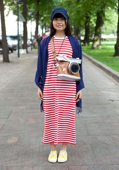 "Nozomi, 21  ""I'm wearing a hat, a bag and a scarf from Japan, a Marimekko Pitkäpaita dress and shoes from Japan.  I like natural clothes and colours like brown and white."""