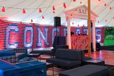 <p> Strings of lights with red Solo cup lampshades hung from the ceiling.</p>