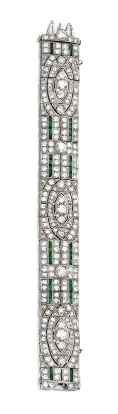 PLATINUM, DIAMOND AND EMERALD BRACELET, CIRCA 1925.  Set with old European-cut and single-cut diamonds weighing approximately 17.50 carats, accented by calibré-cut emeralds, length 7 5/8  inches.