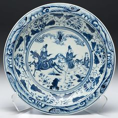 Transitional Blue and White Charger. Chinese, early Qing dynasty, transitional period (1644-1683). A blue and white charger decorated with underglaze blue figures on horseback as well as foliage and floral motifs. Unmarked; dia. 15.75 in.