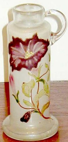 """Galle Glass; Ewer (Cylindrical), Enameled 6 inch.  A very early cylindrical ewer, etched in small script """"E. Galle, Nancy"""". This ewer boasts a plum enameled morning glory and a mauve bud upon graceful ..."""