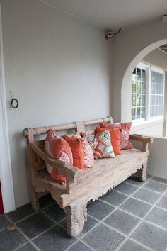 A wabi sabi entryway bench/Source: Digs Digs website Entry Foyer, Entryway Bench, Coral Pillows, Yard Design, Historic Homes, Wood Furniture, Beach House, Living Spaces, Eco Friendly