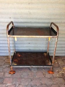 orange steel two-tiered stand, reminds me of my Grandmother's place in Glen Waverly. Ah the memories :-)