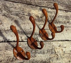 Cast Iron Coat Hook, With Rusty Finish.... is a coating but not too much rust comes off  Heavy duty 4 hole fixing, strong, c/w screws Authentic rust finished  The weight of the hook is 3 1/2 Ounces Overall Height is 4 3/8  Distance out from the wall is 3 3/8 to the top hook and 3 1/4 to the bottom hook  The Oval Back plate is 1 3/8 W x 2 H
