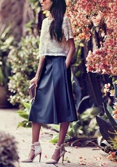 Absolutely stunning! Love the pairing of a rosette mesh top and pleated a-line midi skirt.