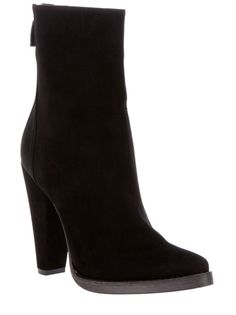 Black lambskin boot from Balmain featuring a pointed toe, a thick sole, a suede covered tapered heel and a back zip fastening.