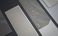 This font! this font this font this font. Elegance! gray and gold, yes! also the little detail on the bottom left corner (is it a camera, a telescope??) v cool.  THE GOLDEN CAMERA 2013 by Paperlux, via Behance