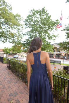 We love the cut out back of this navy maxi!