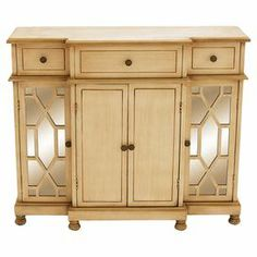 """Perfect for stowing fine china and table linens, this wood cabinet showcases 3 drawers and 4 mirrored doors with lattice overlay.     Product: CabinetConstruction Material: Wood and mirrored glassColor: Rich beigeFeatures:  Four doorsThree drawers Dimensions: 35"""" H x 42"""" W x 14"""" D"""