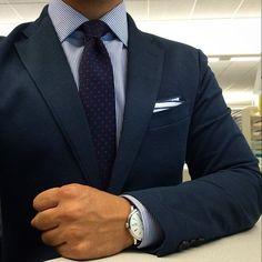 Blue suit with striped shirt and polka dot tie