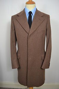 A VINTAGE AQUASCUTUM VENETIAN WOOL OVERCOAT.    Item Description:        A MEN'S UK SMALL 38 REGULAR AS TAGGED (detailed measurements given below). Brown colour. Three buttons. Collar and lapel. Two flapped pockets at the waist. Brown lining with  one internal slit pocket. Single vented. Triple buttoned cuffs. Made by Aquascutum in England from Pure Venetian Wool. Excellent condition and a truly wonderful winter overcoat. Dry cleaned and steam pressed before being listed. Winter Overcoat, Wool Overcoat, Crombie Coat, Dapper Suits, Aquascutum, Bespoke Tailoring, Male Fashion, Trench Coats, Casual Outfits