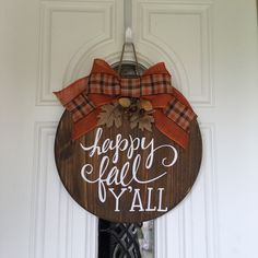 This is a fun 18 wooden door sign /wreath. It is stained brown and has the saying Happy Fall YAll in permanent vinyl on it. It is finished off with a burlap plaid bow and acorns on it. Perfect for your door! It fits great between the door and storm door. Thanksgiving Crafts, Fall Crafts, Holiday Crafts, Diy Crafts, Wooden Door Signs, Wood Signs, Welcome Signs Front Door, Wood Wreath, Fall Door Hangers