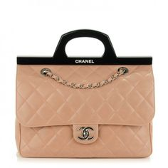 This is an authentic CHANEL Glazed Calfskin Quilted Small CC Delivery Tote in Light Pink. This seasonal shoulder bag is crafted of distressed pink calfskin diamond quilted leather. The bag features silver chain link shoulder straps threaded with leather and a frontal flap with a silver Chanel CC turn lock.  There is a black fabric interior with zipper and patch pockets. This is a gorgeous bag for day or evening with the timeless quality and style of Chanel!