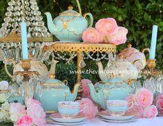 Vintage aqua blue teapots for afternoon or high tea.