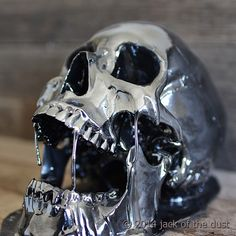 Image of BLACK CHROME MELTING SKULL <BR>Free worldwide shipping <br>(USD)
