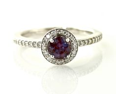 Platinum Alexandrite Ring Diamond Halo Setting Alexandrite Engagement Ring Custom Bridal Jewelry. $1,641.00, via Etsy.