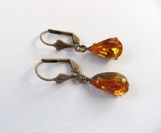 Hey, I found this really awesome Etsy listing at https://www.etsy.com/listing/36949144/vintage-yellow-jewel-glass-teardrop-and